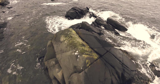 Flying over rocks and waves in lofoten Norway Stock Video Footage