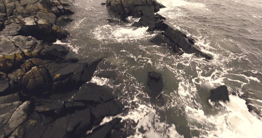 Flying over rocks and waves in lofoten Norway Footage