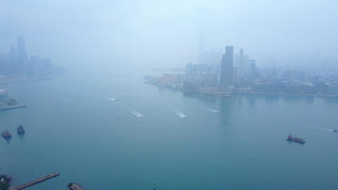 Clouded aerial panorama of Victoria Harbour at early morning GIF