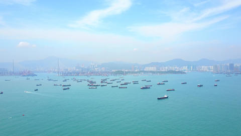 Many small container ships anchored at Victoria Harbour, wide angle aerial shot Live Action