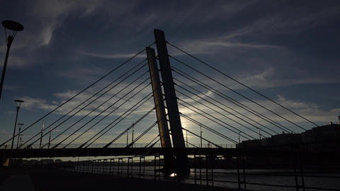 Nice modern cable-stayed bridge silhouetted view against dim evening sky Footage