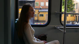 Young adult woman travel in city by tram, portrait of passenger GIF