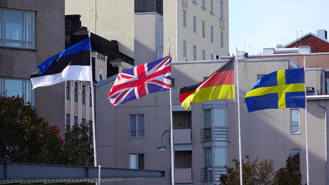 Four European flags wave on wind, telephoto slow motion shot Footage