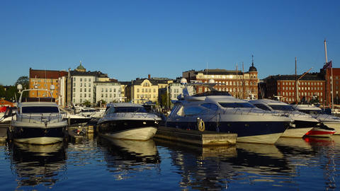 Modern motor yachts at marina, early morning hour, sunrise at city waterfront Footage