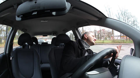 Man sit in car and wait for passenger, fisheye view of vehicle interior Live Action