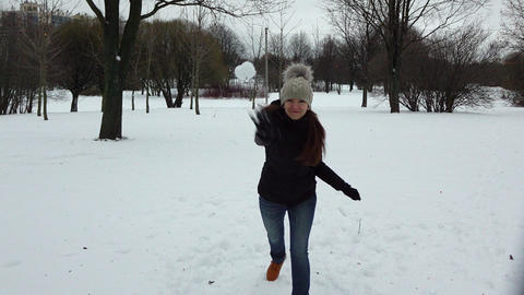 Young woman play snow game, dodge from snowball and throw and hit Live Action