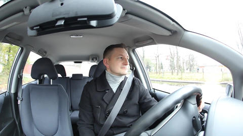 Handsome man ride car and swearing to other drivers, bumpy road GIF