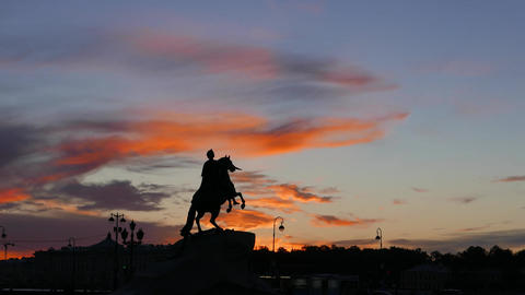 Silhouetted Peter The Great equestrian statue against darkening sky, timelapse Live Action