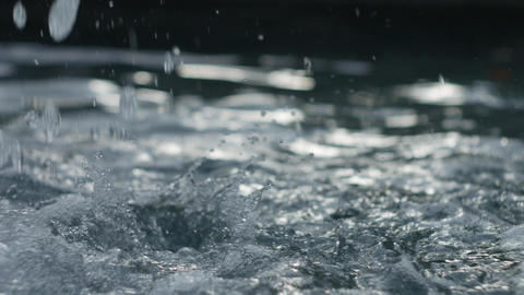 Splashes of water from a fountain - closeup 4K UHD footage Filmmaterial