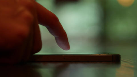 Smartphone touchscreen device close up one finger operating ビデオ