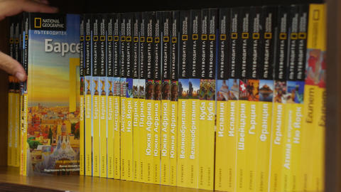National Geographic guidebooks row in a library bookstore shop Live Action