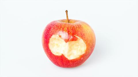 Bitten apple on white background Archivo
