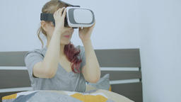Young cheerful woman wearing virtual reality headset playing 360 VR video game Footage