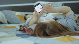 Woman using cellphone in bed Footage