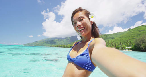 Tropical vacation fun girl waving hello on videochat selfie with smartphone Footage
