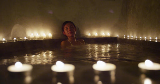 Woman relaxing in spa jacuzzi going out leaving the hot tub spa Live Action
