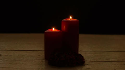 Two red candles burn and roses in romantic time on wood table Filmmaterial