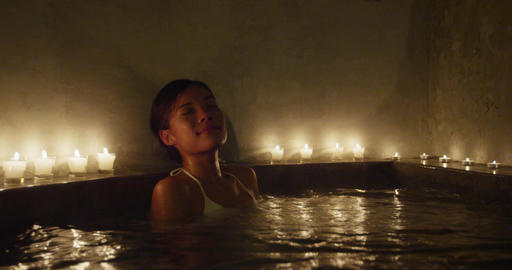Beautiful Woman Relaxing In Jacuzzi At Decorated Beauty Spa Live Action