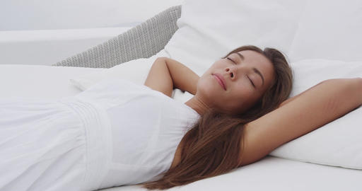 Relaxed Asian woman relaxing sleeping beautiful and calm Live Action