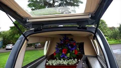 closeup shot of a colorful casket in a hearse or chapel before funeral or burial Image