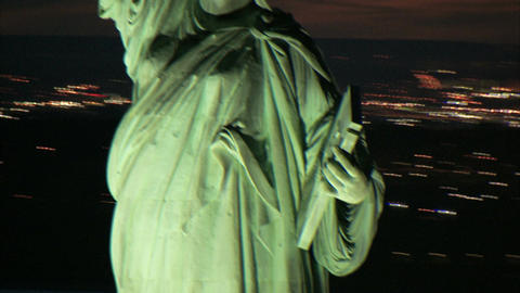 Aerial circling statue of liberty at dusk Live Action