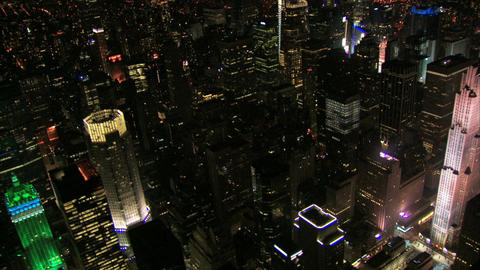 Aerial night shot panning past new york ge building Live Action
