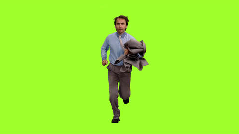Businessman with suit jacket in hand runs on green screen background Footage