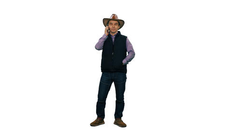 A man in cowboy hat standing and talking on smartphone, alpha channel Footage