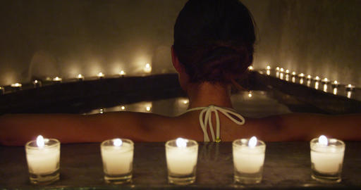 Back view of bikini woman relaxing in jacuzzi hot tub spa Live Action