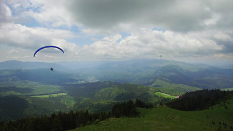 Aerial Paragliding over Mountains and Valleys Image