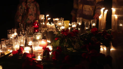 Terrorist attack, people mourn. Flowers and candles in memory of those killed by Image