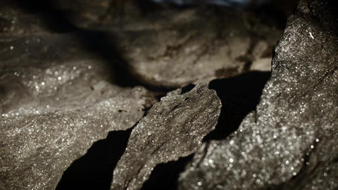 Closeup timelapse of shadows moving over rocks Footage