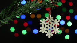 Christmas tree decoration snowflake on the background of sparkling blurred Footage