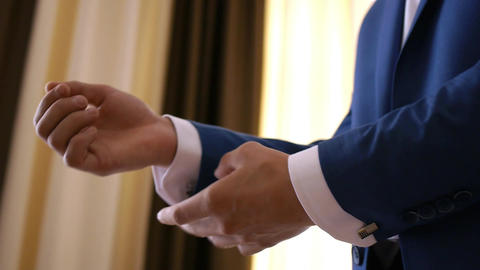 Stylish groom in blue luxury suit wearing cufflinks close up 2 Footage