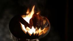 Burning pumpkin on Halloween. Looped Image