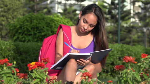 Female Teen Student Writing In Notebook Footage