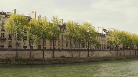 Steadicam walk along the Seine river embankment and residential houses in Paris Footage