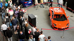 car exhibition - parked cars and people walking and watching cars - interior - L Footage