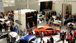 car exhibition - parked cars and people walking and watching cars - interior Footage