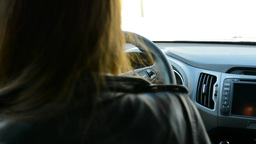 women get in a car - woman opens the door and sits - they talk Footage