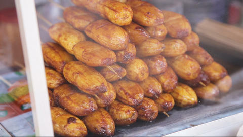 Fried bananas in the street market Footage
