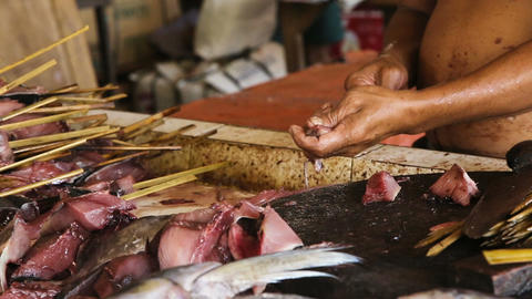 man's hand cut fresh fish Footage