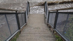Steps down to a dirty river Tilbury Essex UK Bild