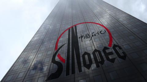 Sinopec logo on a skyscraper facade reflecting clouds, time lapse. Editorial 3D Footage