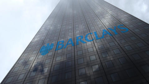 Barclays logo on a skyscraper facade reflecting clouds, time lapse. Editorial 3D Footage