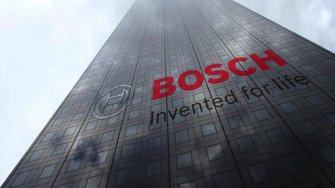 Robert Bosch GmbH logo on a skyscraper facade reflecting clouds, time lapse Live Action