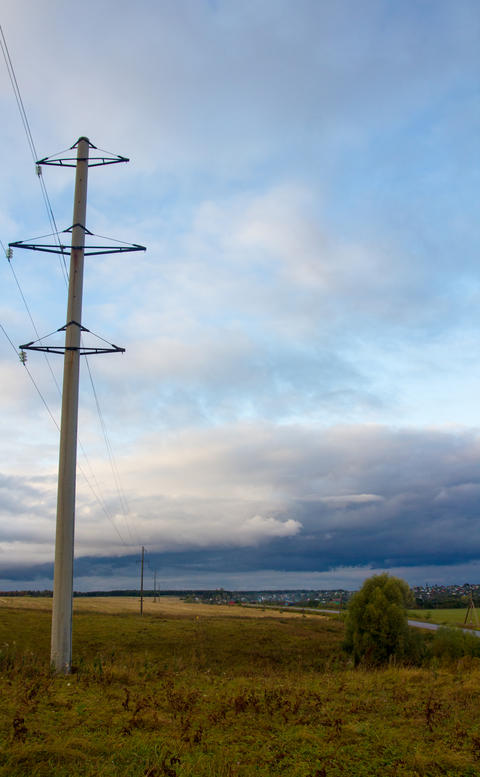 poles with electric wires in the evening autumn field フォト