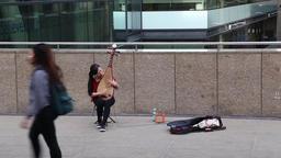 Asian busker playing Pipa, Chinese lute London UK Footage