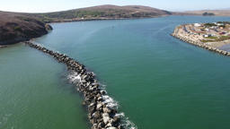 Aerial Flyover Of A Pacific Coast Rock Jetty Footage