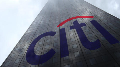 Citigroup logo on a skyscraper facade reflecting clouds, time lapse. Editorial Footage